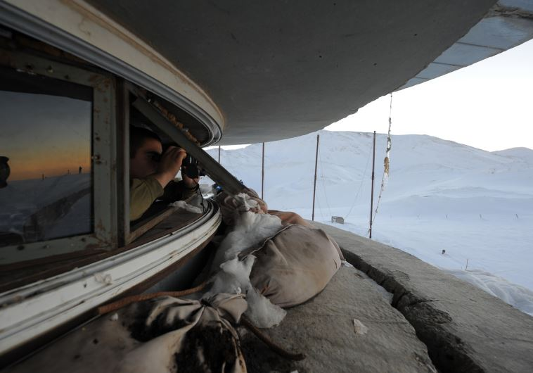 An IDF soldier looks out from a position on Mt. Hermon