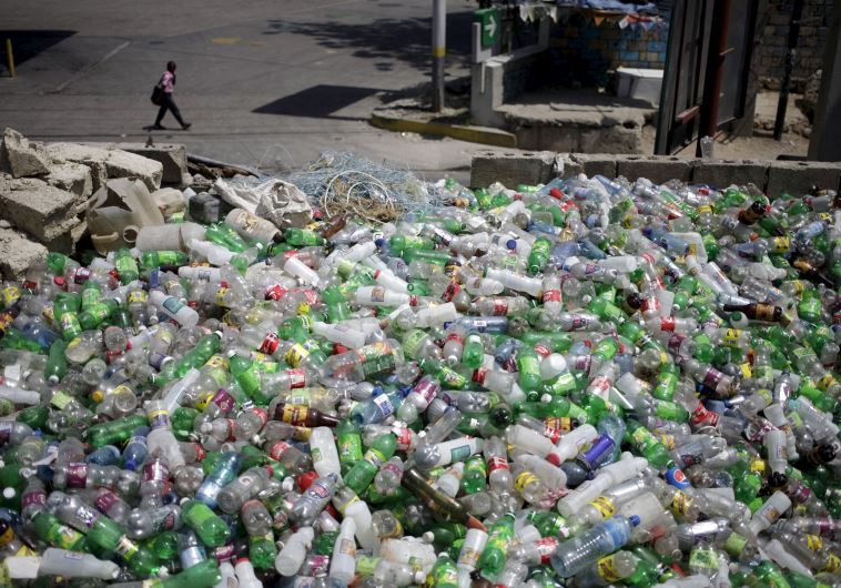 Plastic bottles to be sold for recycling are seen at a storage