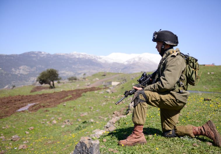 An IDF soldier takes part in drills on the Golan Heights