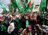 Palestinians supporting Hamas chant slogans during a rally celebrating Hamas student supporters