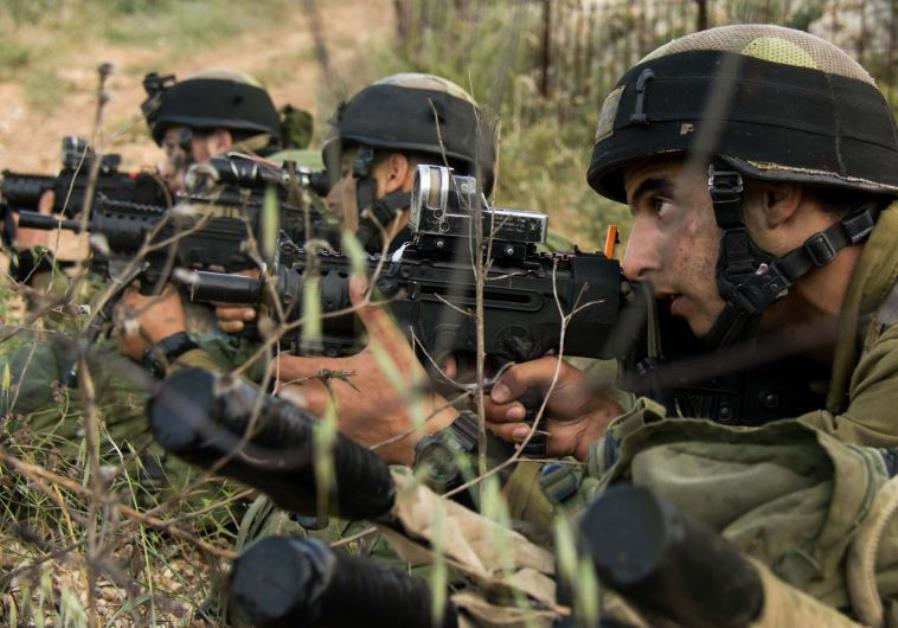 Soldiers with the IDF's Nahal reconnaissance battalion participate in drills