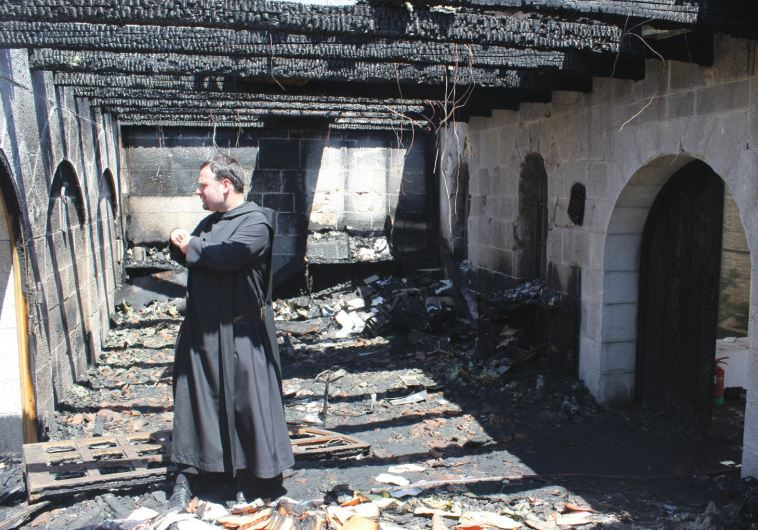 FATHER NIKODEMUS SCHNABEL inspects the damage at Capernaum's Church of the Loaves and Fishes
