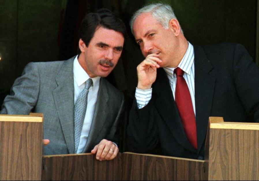 Prime Minister Benjamin Netanyahu (R) confers with Jose Maria Aznar