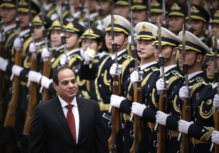 Egypt's President Abdel Fattah al-Sisi inspects honor guards in Beijing