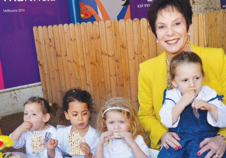 RIVKA LAZOVSKY, chairwoman of the World WIZO Executive, enjoys herself at a WIZO daycare center on K
