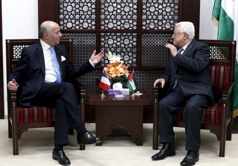 France's Foreign Minister Laurent Fabius meets Palestinian President Mahmoud Abbas