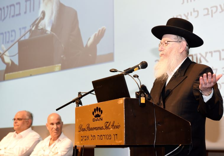 Deputy Health Minister Litzman speaks to an audience at Tel Aviv's Dan Panorama Hotel