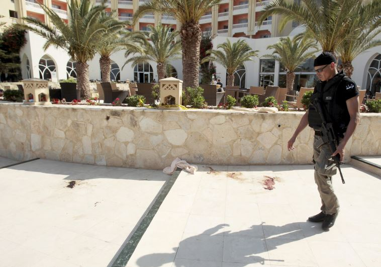 A police officer walks past blood at the Imperiale Marhaba hotel, Tunisia.