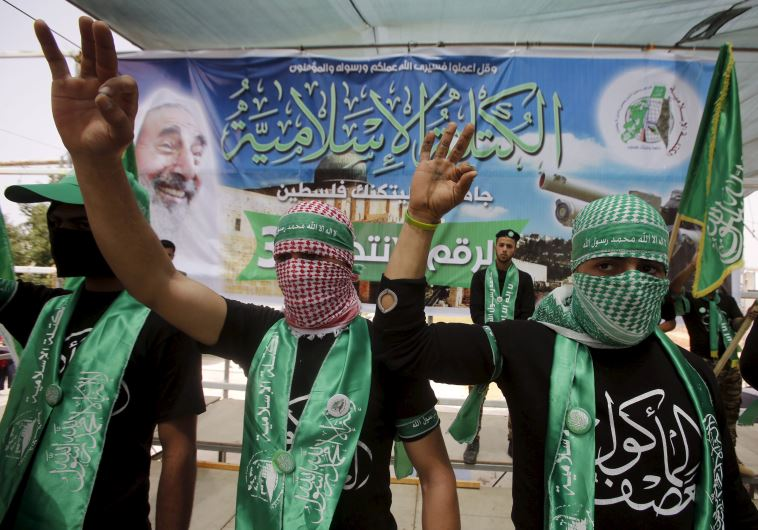 Palestinian students supporting Hamas demonstrate in the West Bank city of Hebron