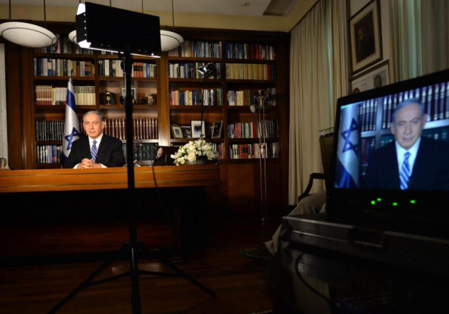PRIME MINISTER Benjamin Netanyahu is interviewed in his Jerusalem office yesterday by international