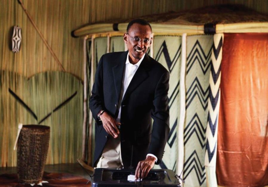 RWANDAN PRESIDENT Paul Kagame casts his ballot during the presidential election in Kigali in 2010