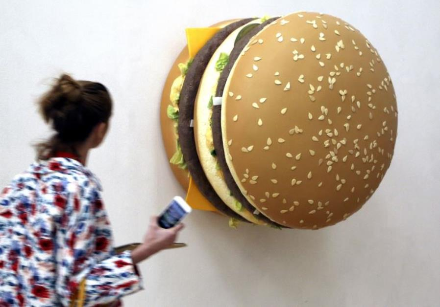 A woman looks at a creation by Tom Friedman named 'Big Big Mac'