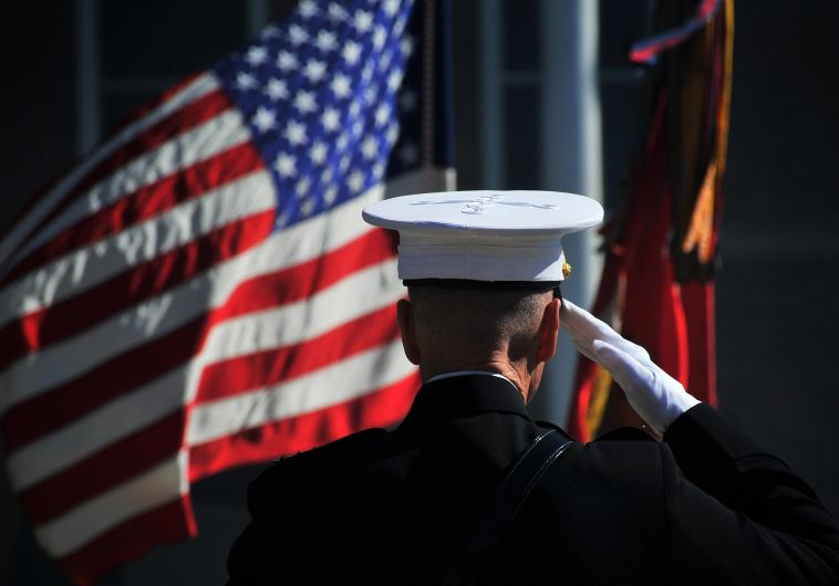 US Marine Corps Gen. James F. Amos, the outgoing commandant of the Marine Corps, salutes the colors