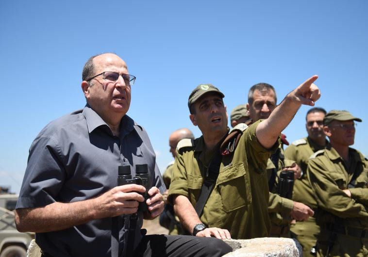 Defense Minister Moshe Ya'alon is briefed by IDF officers on the Golan Heights