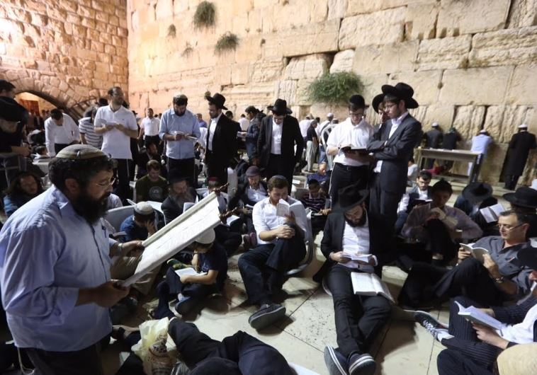 IN PICTURES: Worshipers flock to Western Wall as Tisha Be'av begins