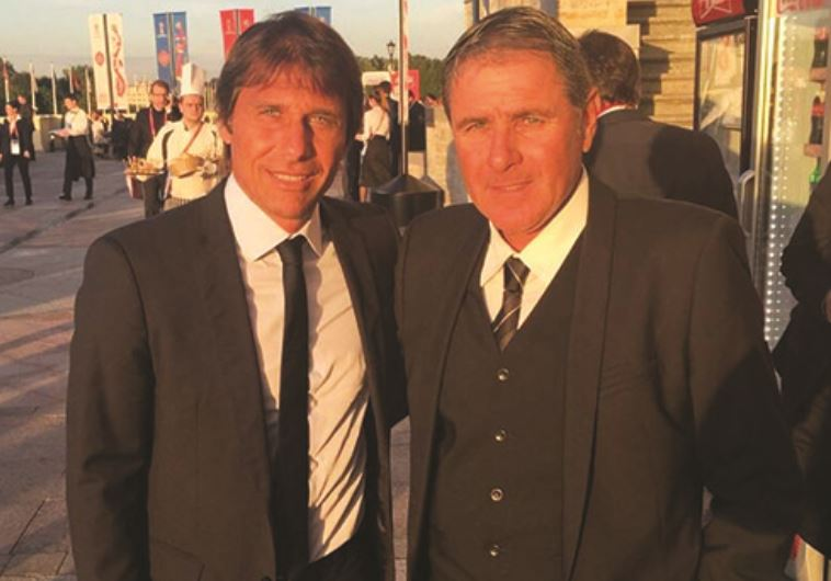Israel national team coach Eli Gutman (right) met Italy coach Antonio Conte near St. Petersburg