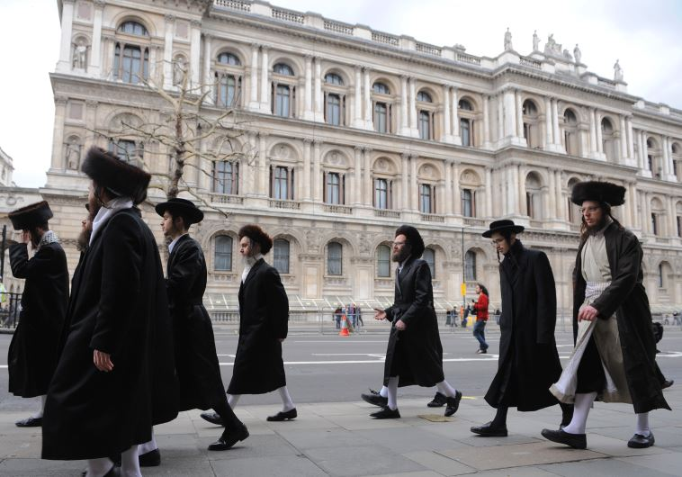 Orthodox Jews walk along Whitehall in central London