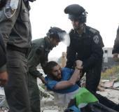 Security forces detain a settler in Beit El