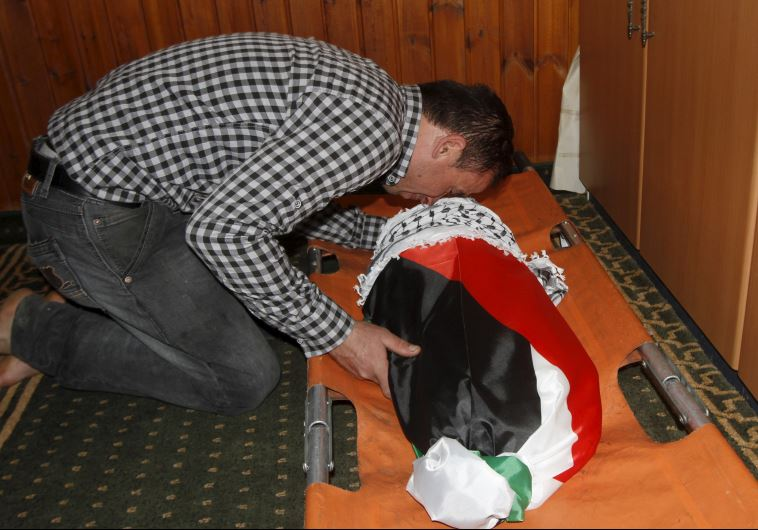 A relative mourns 18-month-old Palestinian baby Ali Dawabsheh