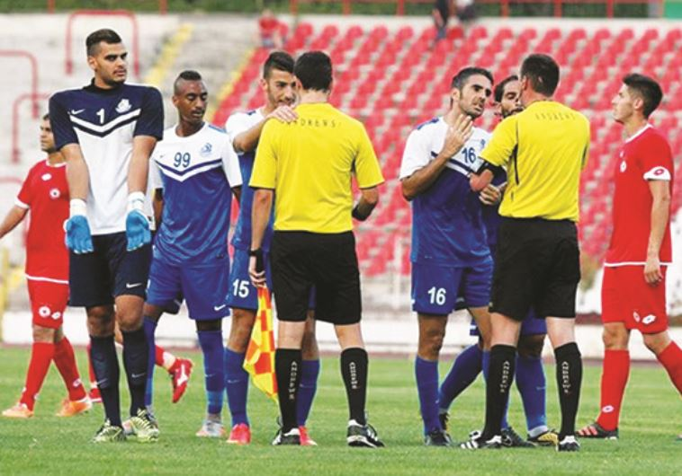 Ashdod SC players (in blue) were unhappy with the officiating staff