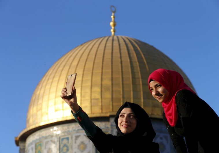 Salma Salame (L), 27, from the Israeli town of Baka al-Gharbiya, takes a selfie photo with a friend