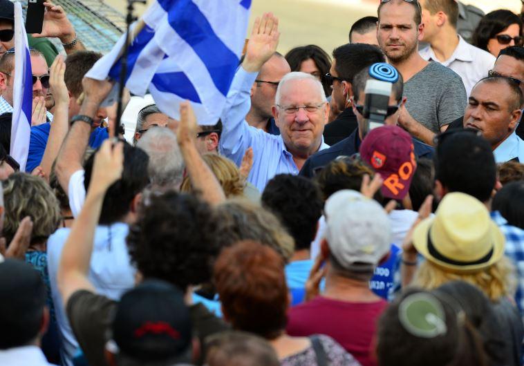 President Reuven Rivlin greeting supporters outside the President's Residence