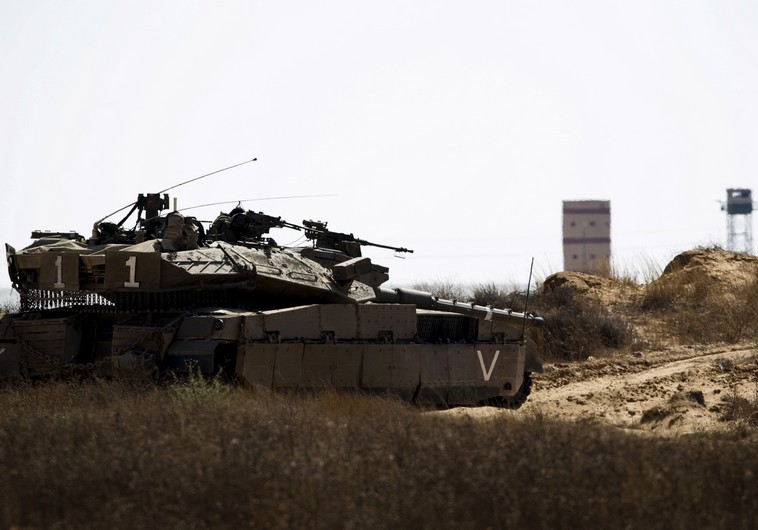 An IDF tank takes position along Israel's border with Egypt's North Sinai