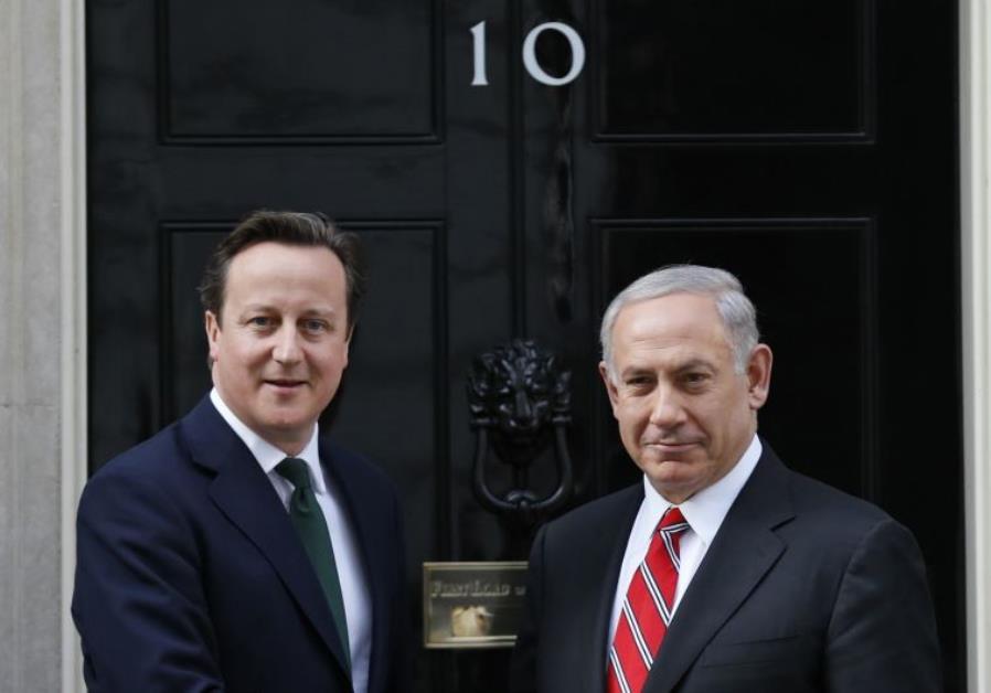 Britain's Prime Minister David Cameron (L) greets PM Benjamin Netanyahu at Number 10 Downing Street