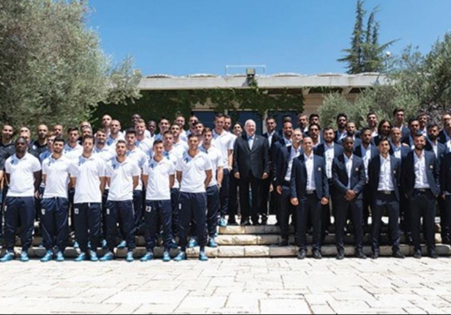 Last season's treble winner Maccabi Tel Aviv (right) and league runner-up Ironi Kiryat Shmona (left)