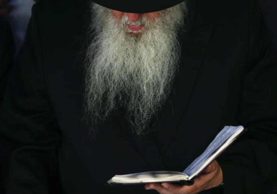 A visitor prays at the gravesite of the Lubavitcher Rebbe, Rabbi Menachem Mendel Schneerson