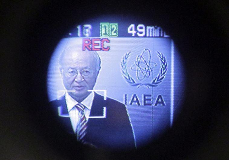 International Atomic Energy Agency (IAEA) Director-General Yukiya Amano is seen through a camera