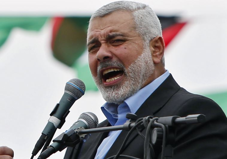 Ismail Haniyeh talks to his supporters during a Hamas rally in Gaza City