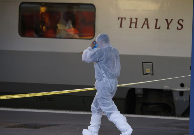 French investigating police in protective clothing prepare to enter Thalys high-speed train