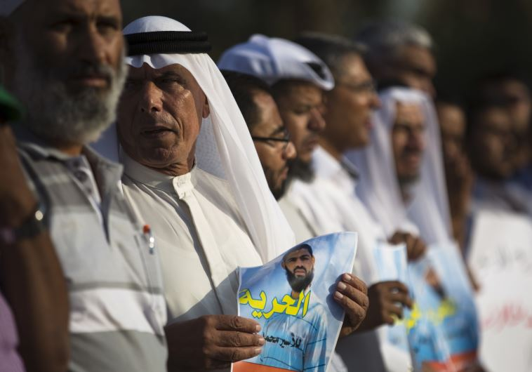 Beduin demonstrators hold signs during a protest in the southern town of Rahat
