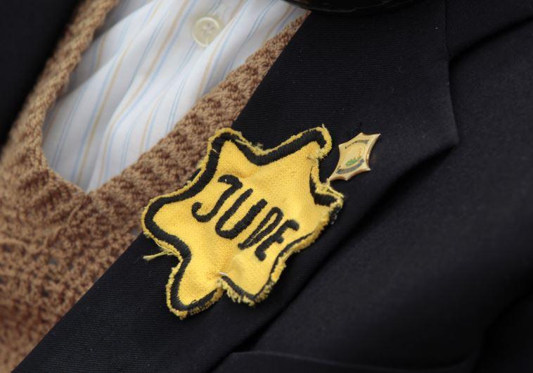 Polish born Mordechai Fox, an 89-year-old Holocaust survivor, wears a yellow Star of David