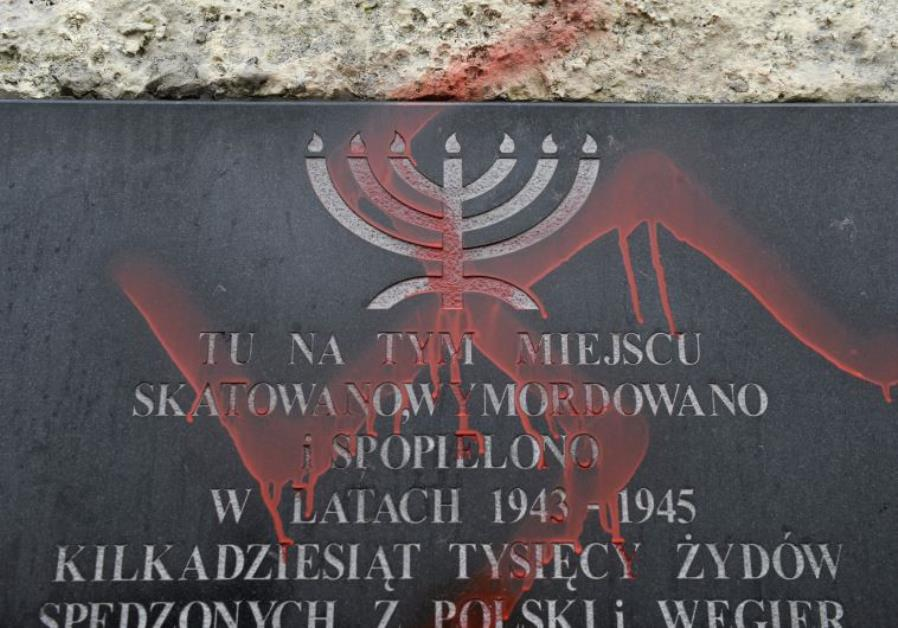 Anti-Semitic graffiti is seen on a monument dedicated to the victims of the Krakow ghetto
