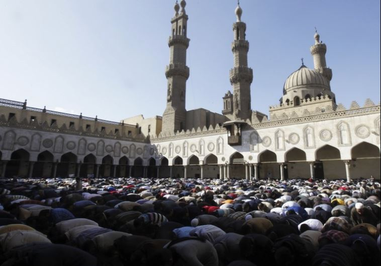 Egyptians attend Friday prayers at Al Azhar mosque in Cairo