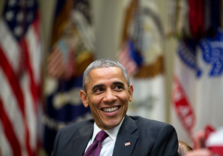 US President Barack Obama laughs during a meeting at the White House