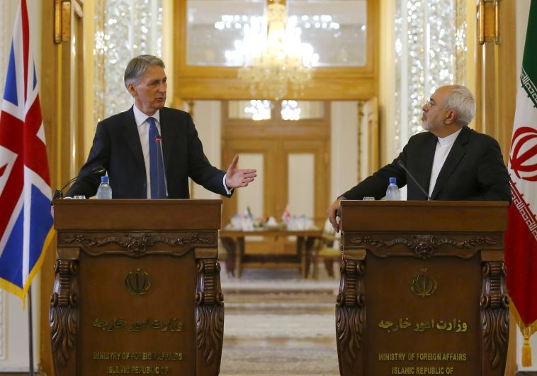 Britain's Foreign Secretary Philip Hammond (L) and Iran's Foreign Minister Mohammad Javad Zarif