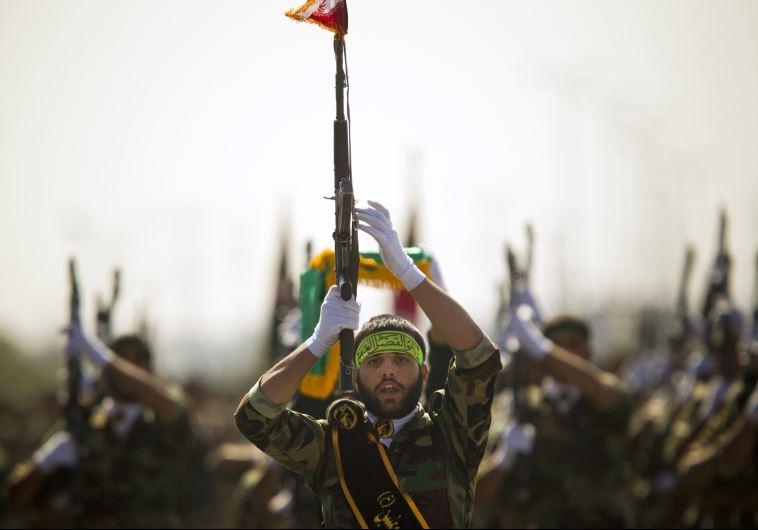 Members of Iran's Basij militia march