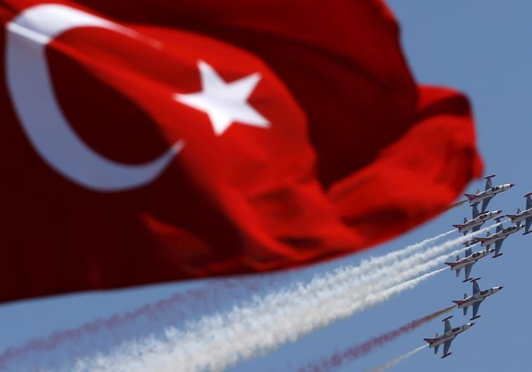 Turkish Stars, the aerobatic team of the Turkish Air Force, perform a maneuver