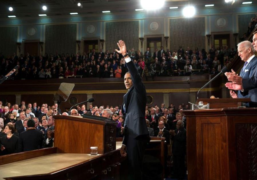 US President Barack Obama acknowledges applause during the State of the Union address