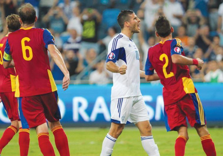 Israel striker Tomer Hemed (center) celebrates after scoring his team's third goal