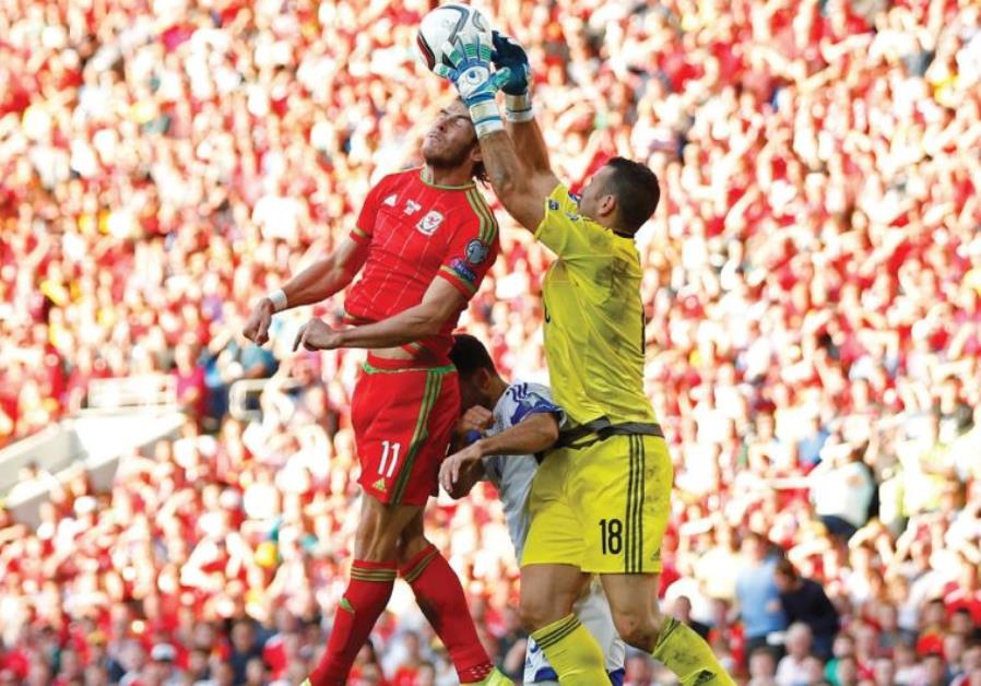 Israel goalkeeper Ofir Martziano (right) denied Wales superstar Gareth Bale (left)