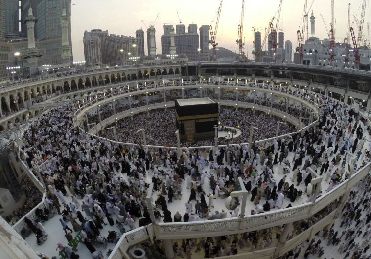 Muslim pilgrims pray around the holy Kaaba during their final circling at the Grand Mosque