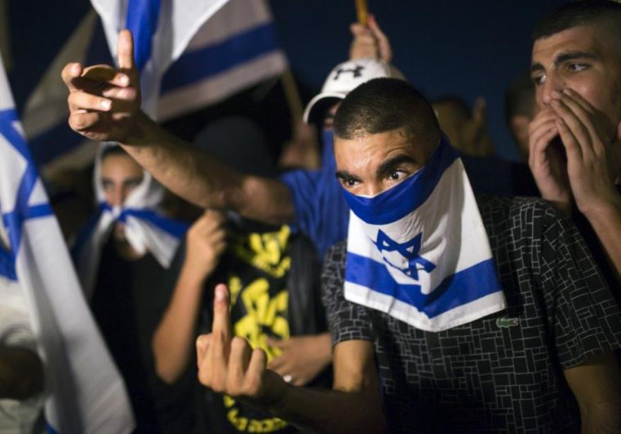 A right-wing Israeli activist gestures during a counter-protest