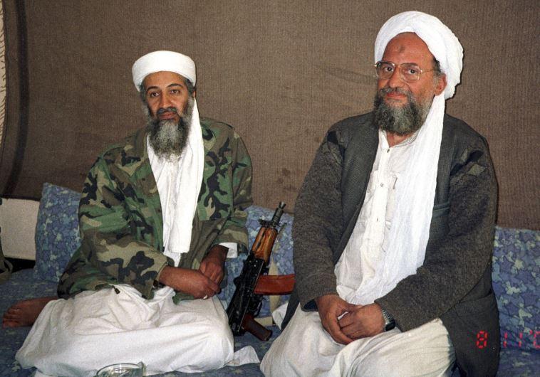 Osama bin Laden (L) sits with his adviser and purported successor Ayman al-Zawahri