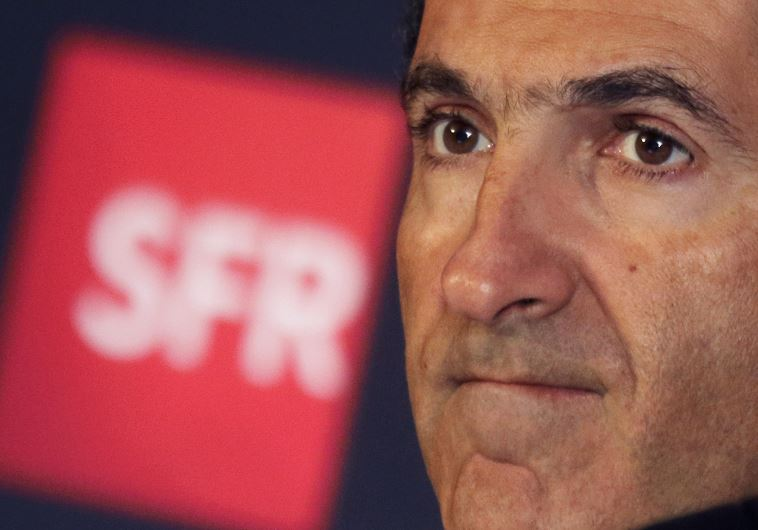 Patrick Drahi, Franco-Israeli businessman, attends a news conference in Paris