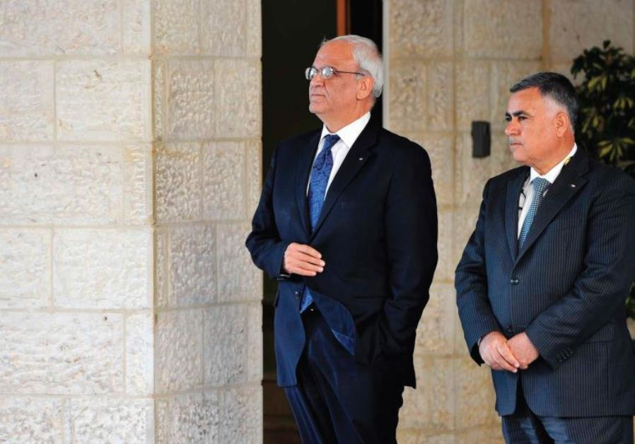 CHIEF PALESTINIAN negotiator Saeb Erakat (left) waits for for a foreign visitor