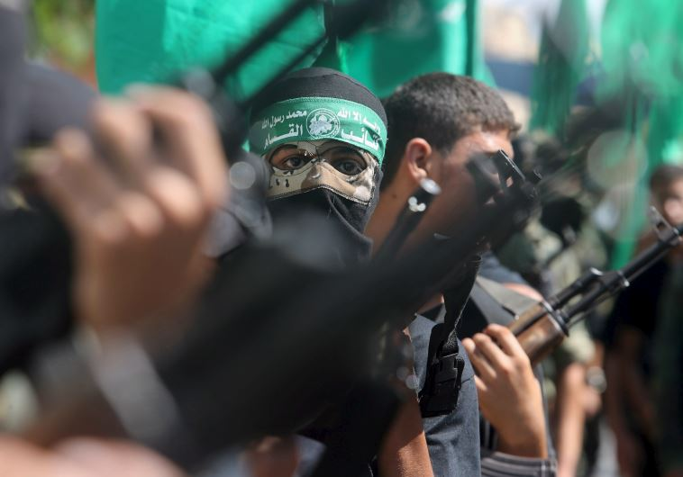 Palestinian Hamas militants take part in a protest against Israel